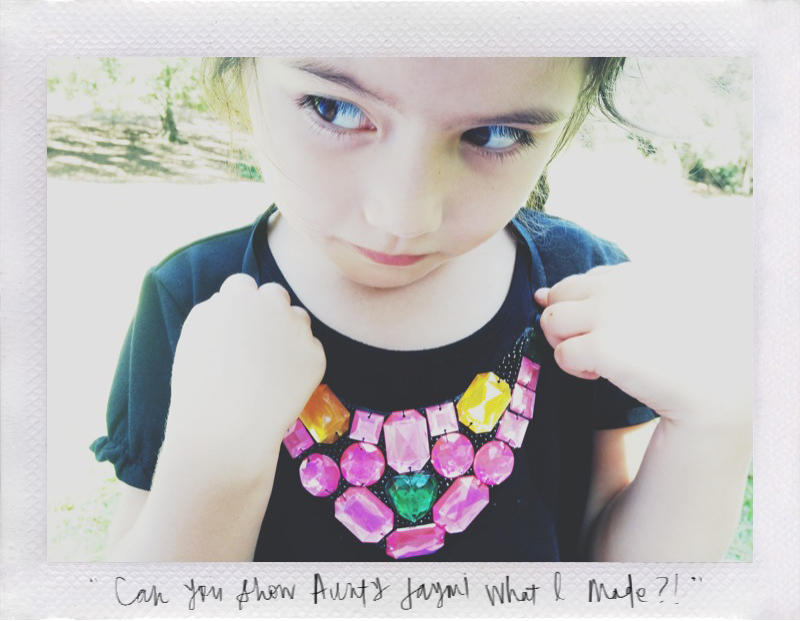04 September 2013 Evie wanted to show her Auntie Jaymi the necklace that she made.